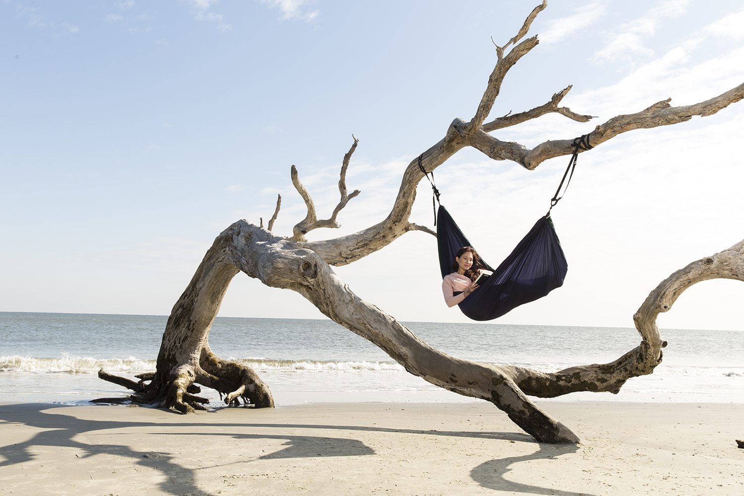 Ryan Hayslip photograph of Amy West in a hammock on driftwood beach in Jekyll Island.