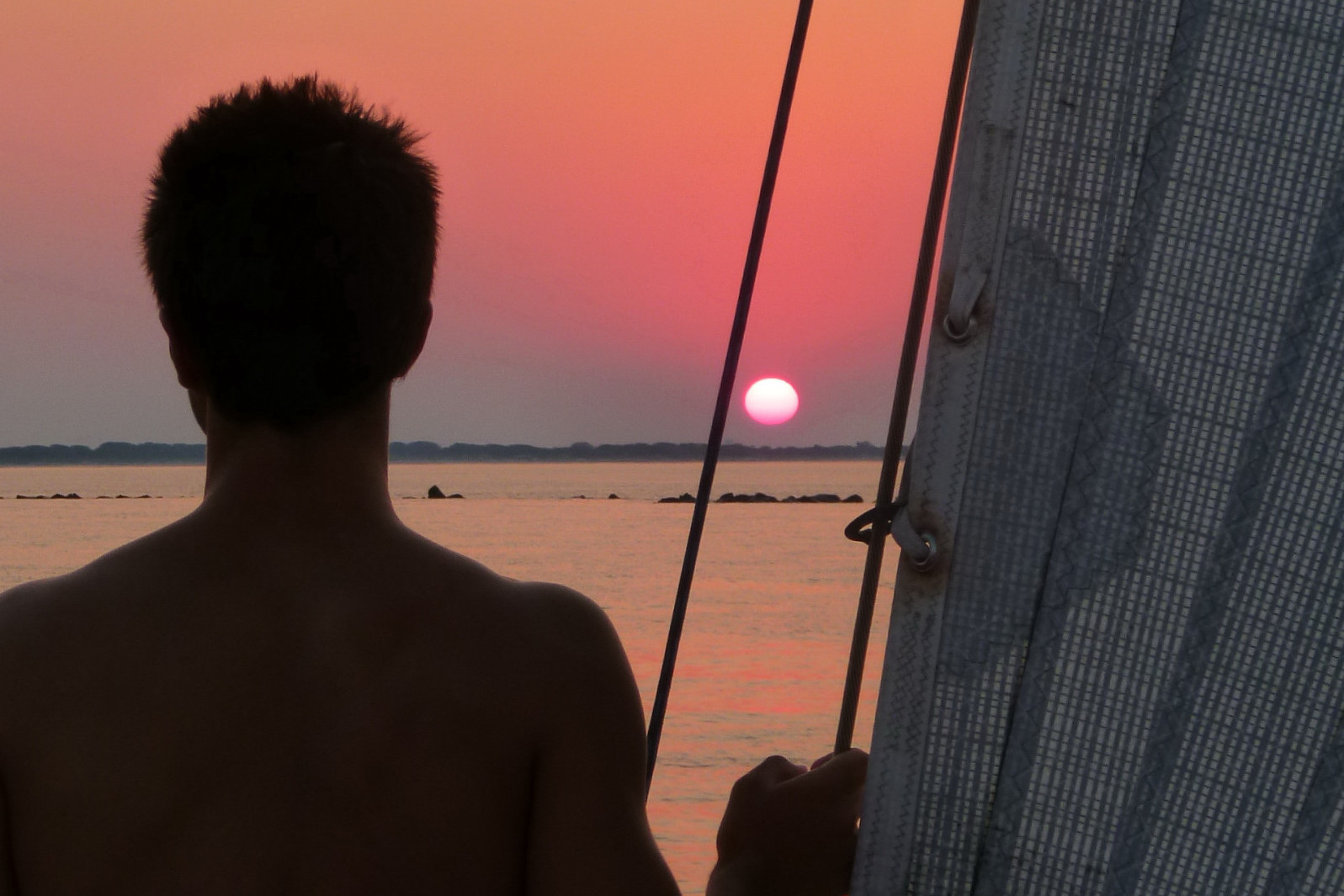 Sunset at sea on Now and Zen private charters