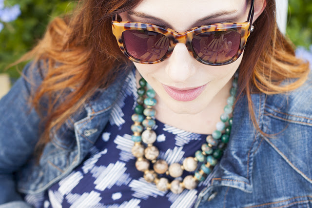 Amy West in Anthropologie Sunglasses, jean jacket, necklace, and swing dress