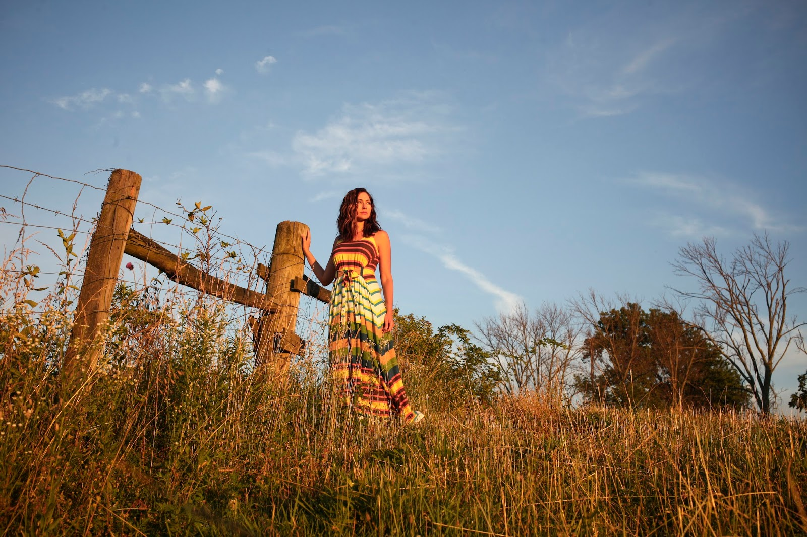 Amy West watches the sun set in this striped maxi dress on a farm in Kentucky