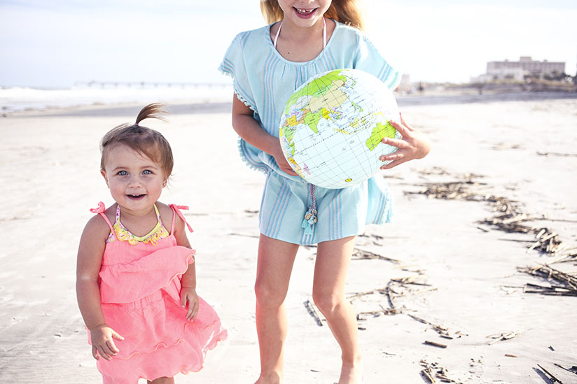 Sisters on Jacksonville Beach wearing colorful dresses by Sunuva