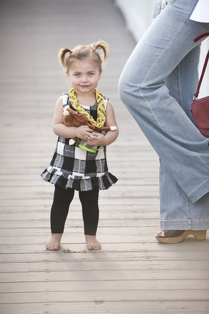Toddler in black gingham tunic by Little Edge Threads