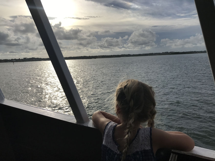 Little girl watching the sunset aboard the Black Raven Pirate Ship