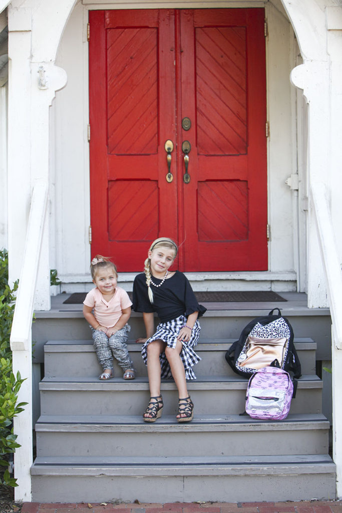 Sisters sitting on the steps of a church